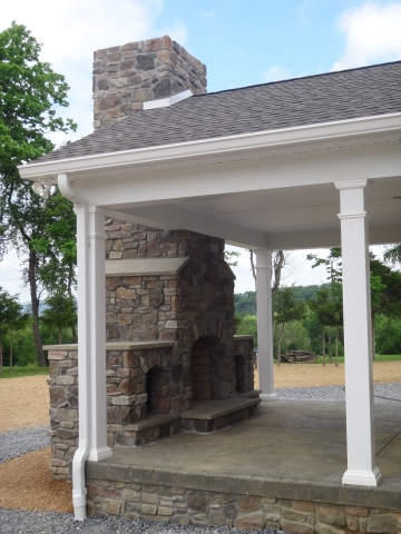 stone fireplace in outdoor living area