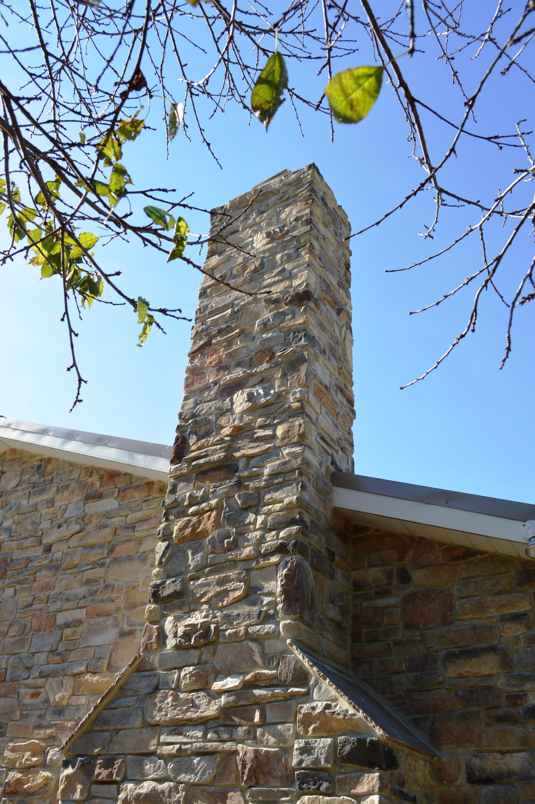 Stone chimney on colonial renovation in Clear Spring, MD by Mt. Tabor Builders, Inc.