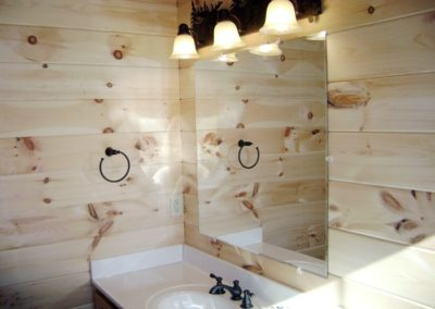 Bathroom with knotty pine walls
