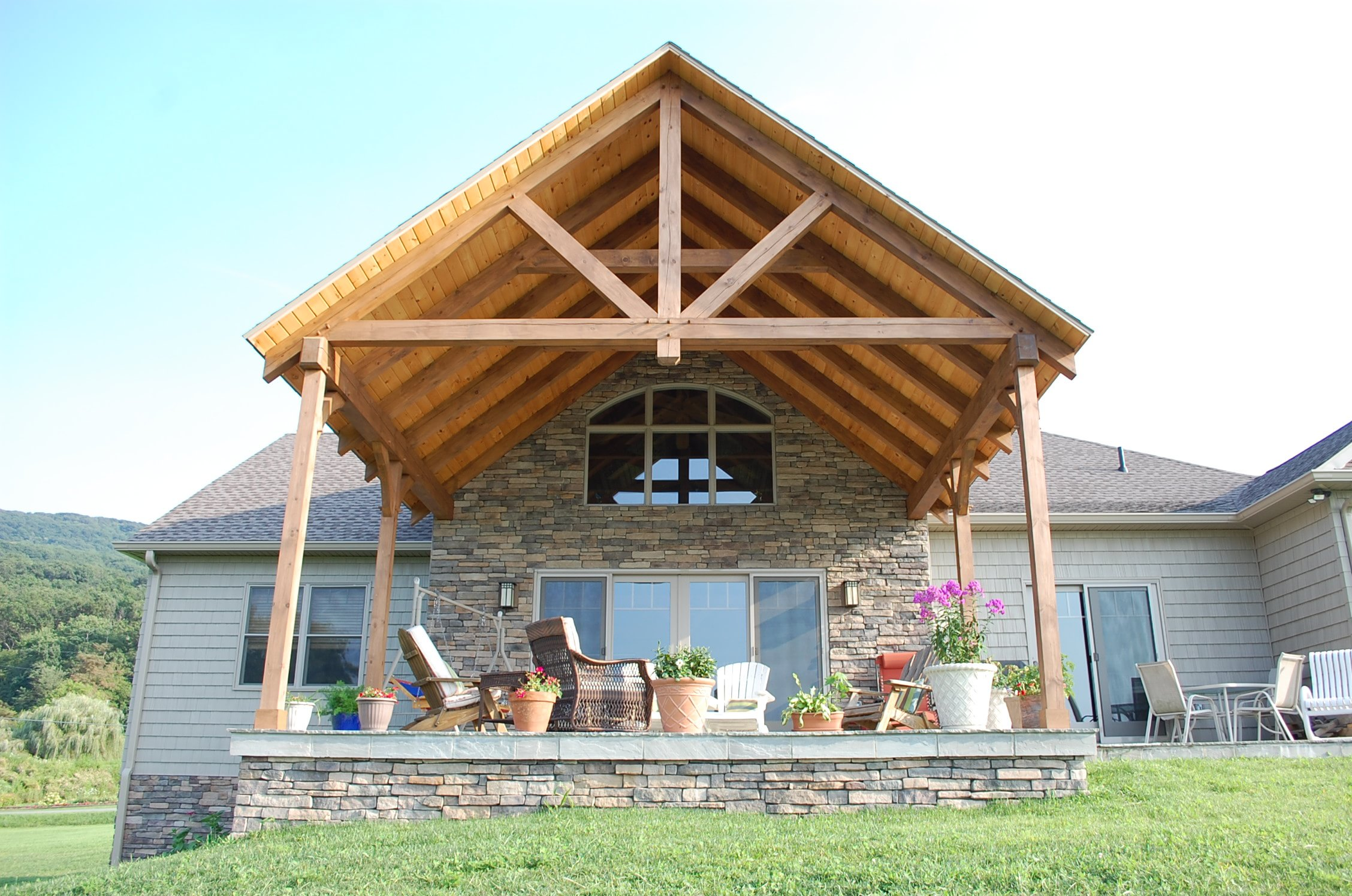Covered patio on timber frame home built by Mt. Tabor Builders, Inc.