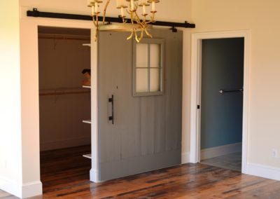 Barn door in Custom Home in Clear Spring, MD built by Mt. Tabor Builders using reclaimed wood for floors and exposed beams