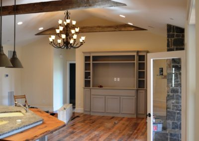 Kitchen in Custom Home in Clear Spring, MD built by Mt. Tabor Builders using reclaimed wood for floors and exposed beams