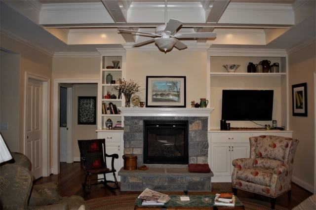 Williamsport, MD Cape Cod living room with stone fireplace in custom home built by Mt. Tabor Builders of Clear Spring, MD